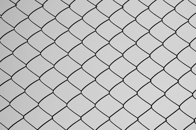 Fence Backgrounds Full Frame No People Security Boundary Safety Pattern Chainlink Fence Protection Day Barrier Metal Outdoors Close-up Nature Focus On Foreground Selective Focus Repetition Sky