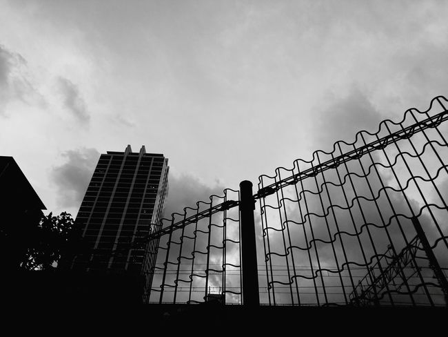 Protection Sky Cloud - Sky Steel Outdoors Architecture Day Skyscraper No People City Building Exterior Blackandwhitepics Monochrome World Blackandwhite Black And White Collection  Blackandwhite Photography Low Angle View City Cityscape Blackandwhiteonly Blackandwhitephoto Blackandwhitephotos Dramatic Sky Silhouette