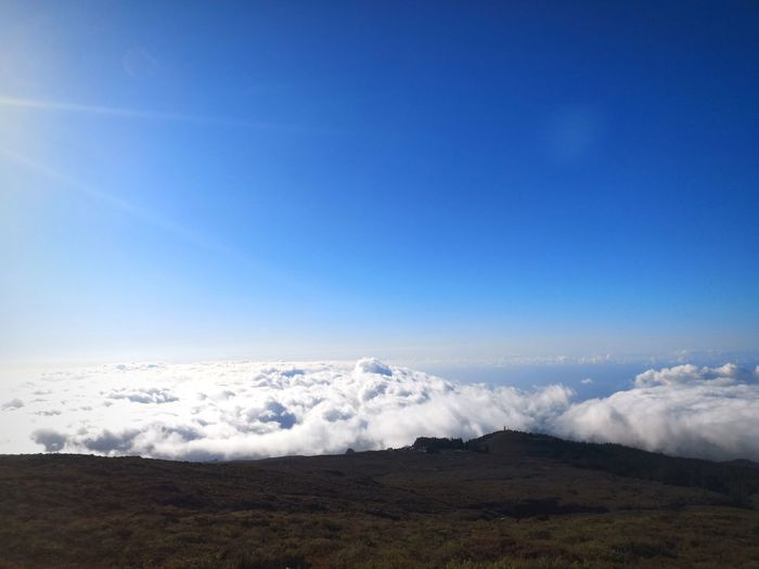 Scenic view of clouds against sky from a mountain top