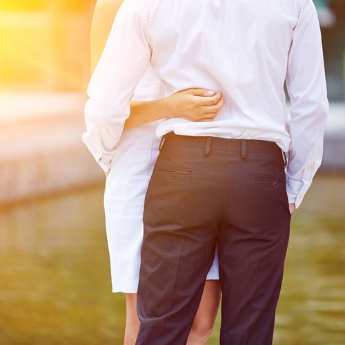 rear view of man standing against blurred background Adult Back Bum Business Businessman Businesswoman Buttocks Career Clothing Couple Day Embrace Entrepreneur Focus On Foreground Formal Get Married Hand Hold Hug Leisure Activity Lifestyles Love Loving Man Marriage  Men Midsection Nature Occupation One Person Outdoors Outside Partnership People Real People Rear View Romantic STAND Standing Summer Sun Sunny Tenderly Together Uniform Valentine Day Water Wedding Woman Women