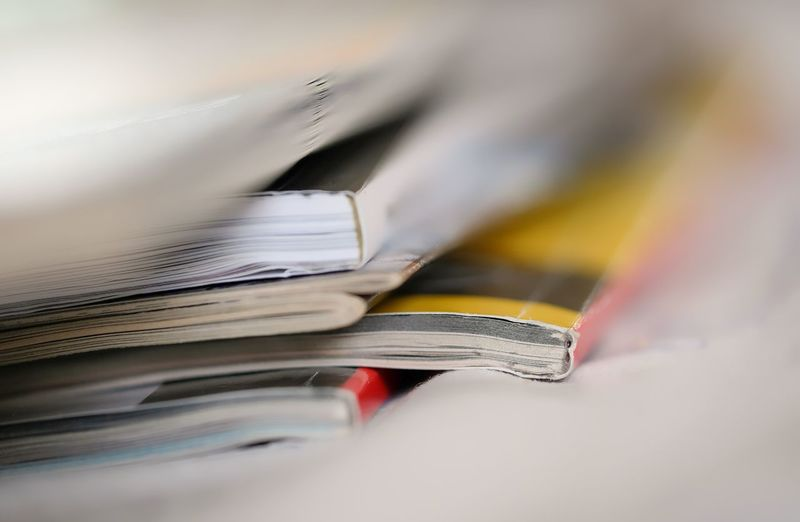 Bücher  Hefte Lesen Analog Blurred Motion Book Close-up Document Education Indoors  Large Group Of Objects Learning Literature Newspaper No People Open Page Paper Paperwork Publication Selective Focus Stack Still Life Table
