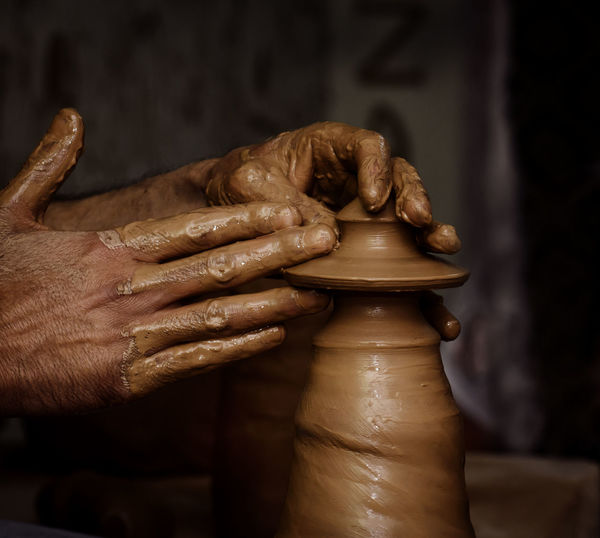 Potter shaping clay on the pottery wheel Hand Art And Craft Craft Skill  Clay Pottery Close-up Making Spinning Creativity Sculptor Mud Finger Working Indoors  One Person Human Hand Pot Class ArtWork Artist Asian  Cappadocia Ceramics Design