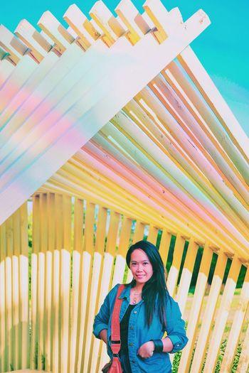 Portrait Of Smiling Woman Below Built Structure