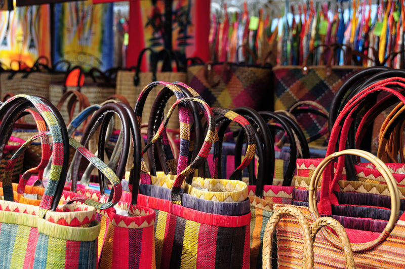 Close-up of multi colored bags for sale in market