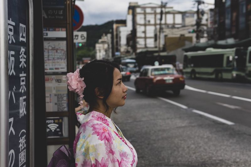 My first trip in Japan and I select this picture because look like old film in the past Bus Stop Japanese Style The Past YUKATA Kimono Cinema Cinematic Waiting Travel Destinations Kyoto Japan Real People One Person Lifestyles Building Exterior Side View Women My Best Travel Photo City Mode Of Transportation Transportation Focus On Foreground Standing Street Car Headshot Motor Vehicle