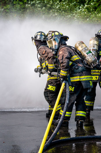 Day Fire Suppression Firefighters In Action Firehose Nature Outdoors Vertical Water