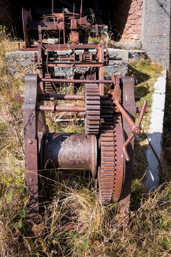Rusty gears and winch mechanism. Old machinery Day Abandoned No People Obsolete Machinery Plant Metal Damaged Land Old Nature Deterioration Rusty Decline Run-down Grass Transportation Agricultural Machinery Agriculture Wheel Outdoors Pollution Mechanism