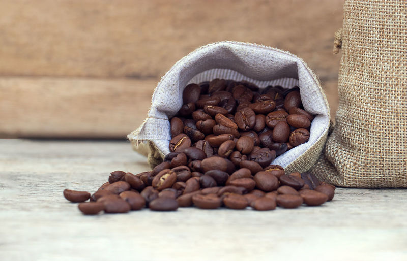 Beans Coffee Bag Brown Burlap Caffeine Close-up Coffee Coffee - Drink Food Food And Drink Freshness Indoors  Jute Large Group Of Objects No People Raw Food Roasted Coffee Bean Sack Selective Focus Still Life Table