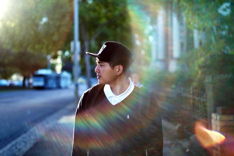 Rainbow. One Person Lifestyles Young Adult City Young Men Waist Up This Is Queer Men Casual Clothing Adult Street Lens Flare Outdoors