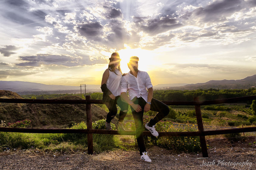 Beauty In Nature Bright Casual Clothing Cloud - Sky Field Full Length Lens Flare Lifestyles Mountain Mountain Range Nature Non-urban Scene Outdoors Person Rear View Scenics Sky Sun Sunbeam Sunlight Togetherness Tranquil Scene Tranquility