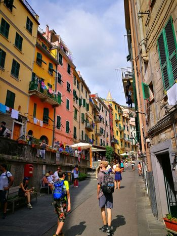 Walking around in Riomaggiore. Riomaggiore Riomaggiore, Riomaggiore, Italy, Architecture, Sea, Town, Beach, Brick, View, Harbor, Clothes, Sun, Window, Blue, Square, Mediterranean, House, Terrace, Europe, Italian, Colorful, Vacation, Wave, Cloud, Shutters,village, Coast, Wall, Tourism, Beautiful, Holiday, Trave Riomaggiore Cinque Terre Riomaggiore Liguria Italy Cinque Terre Cinque Terre Liguria Cinqueterre Cinque Terre Italy Cinque Terre Cityscape Cinque Terre Riomaggiore Liguria Liguria,Italy Liguria, Italy Ligurian Coast. Liguria Di Levante Ligurian Riviera Ligurian Style Liguria Riviera Di Levante Liguria Cinque Terra Italy City Market City Street City Life Sky Architecture Awning Window Box Narrow Pedestrian