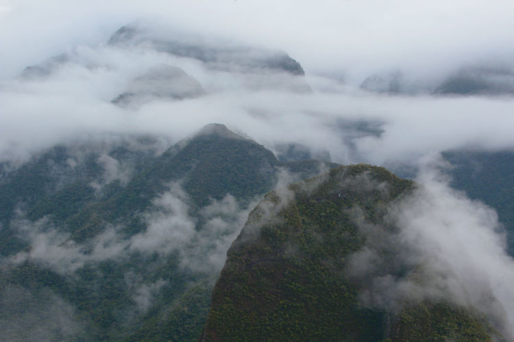 High angle view of fog on mountain against sky