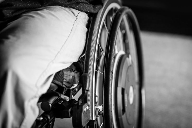 Midsection of person sitting on wheelchair