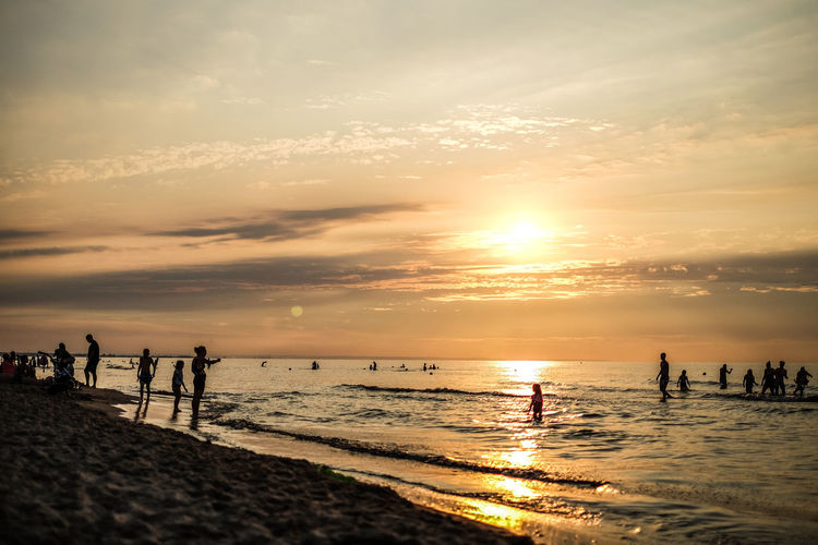 FUJIFILM X-T10 Vacations Beach Beauty In Nature Cloud - Sky Fujifilm Group Of People Horizon Horizon Over Water Land Leisure Activity Lifestyles Men Nature Orange Color Outdoors Real People Scenics - Nature Sea Silhouette Sky Sun Sunset Wasiak Water
