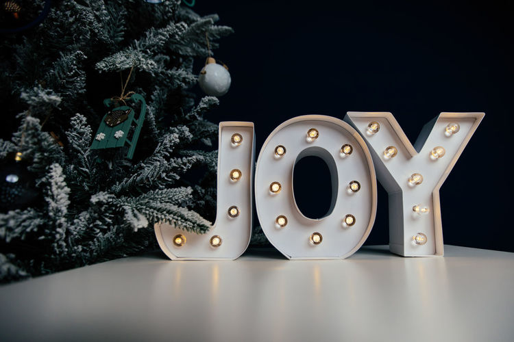 Close-up of christmas decoration on table against black background