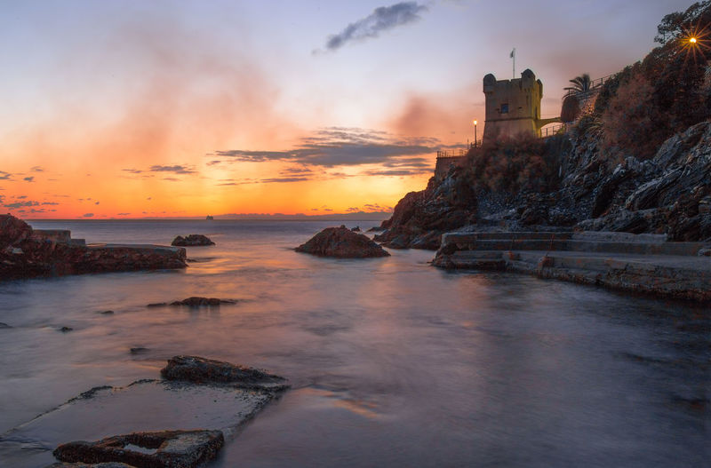 Colorful Village Seaside Night Nature Sunset Blue Italy Beauty Genoa Nervi  Summer Sky Yellow Natural Light Water Wallpaper Travel Landscape Outdoor Architecture Sea View Building Sun Gold Tourism Relax Rock Scenic Sunlight Mountain Landmark Coast Historic Horizon Scenery Land Town Boat Destination Panorama Mediterranean  Coastline Liguria Reflexes Lights Castle Genova