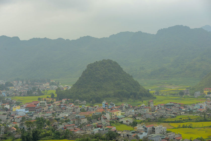 Beautiful View of Quan Ba town in Ha Giang district during cloudy and foggy morning. Witness of the twin mountain . The road is the gateway to the Dong Van Karst Plateau Geopark Quản Bạ World Heritage Site By UNESCO Unesco Landscape Geopark Town Paddy Fields Architecture Mountain Built Structure Building Exterior Building Plant Environment Day Tree Nature Fog Scenics - Nature Sky Residential District Beauty In Nature No People High Angle View Land Outdoors TOWNSCAPE