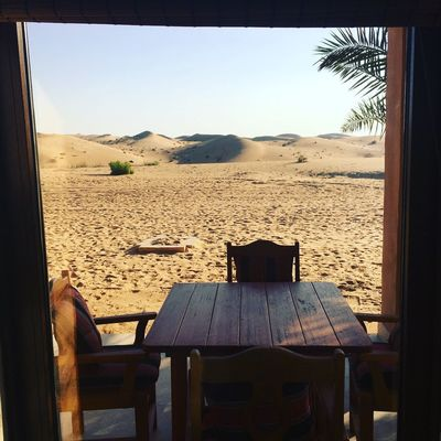 Desert view from window Desert Sky Land Chair Seat Nature Beach Table No People Tranquil Scene Tranquility Sand Sunlight Outdoors