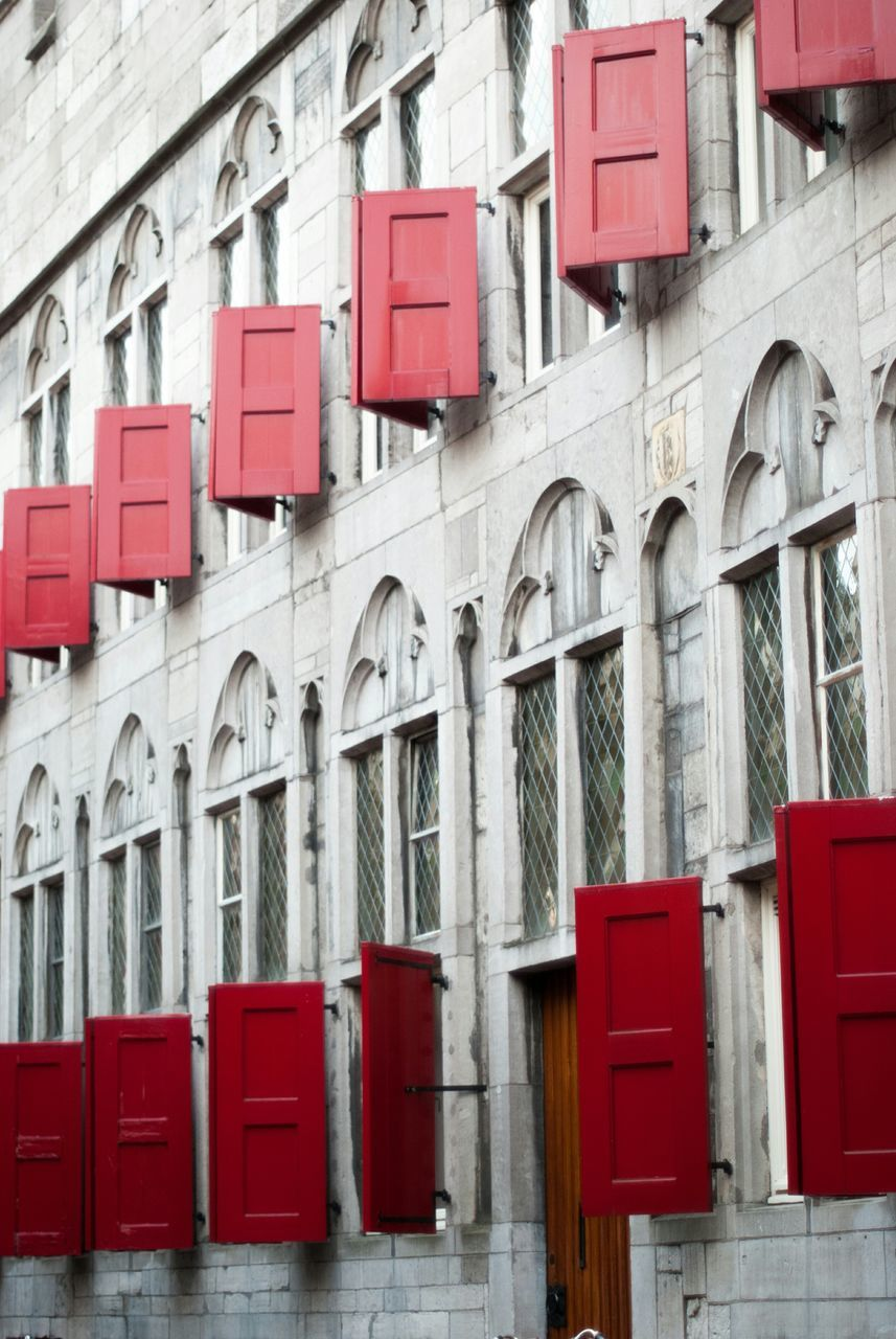 Facade Of Building With Red Windows