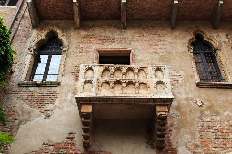 Juliet's balcony - Verona - Italy Arch Architecture Arena Balcony Brick Wall Building Exterior Built Structure City Coluseum Damaged Day Exterior Façade Historic History Italy Low Angle View Obsolete Old Outdoors Romeo And Juliet Stone Material Verona Weathered Window
