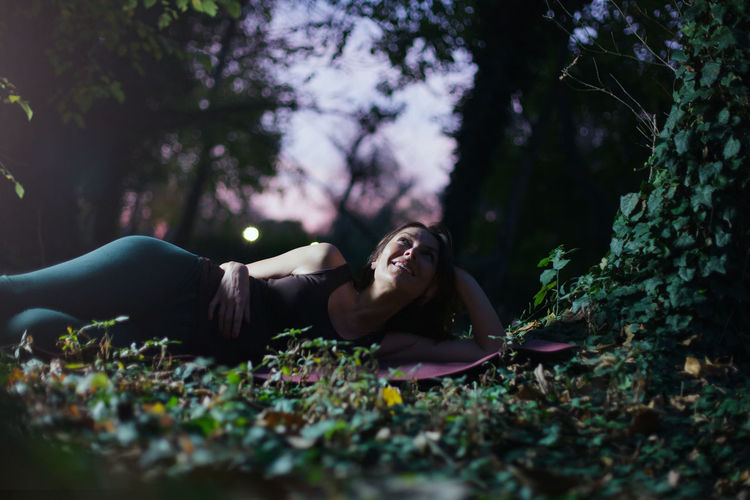 Woman lying down on land
