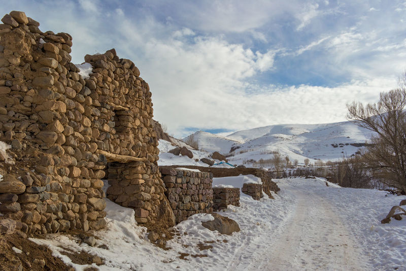 The small village of Kandovan near to Tabriz, Northern Iran. Also known as Irans Cappadocia due to its unique rock formations that locals and caved out and used as their homes for hundreds of years. Kandovan Architecture Beauty In Nature Cloud - Sky Cold Temperature Day Environment Landscape Mountain Mountain Range Nature No People Rock Scenics - Nature Sky Snow Snowcapped Mountain Solid Stone Wall Tranquil Scene Tranquility Winter