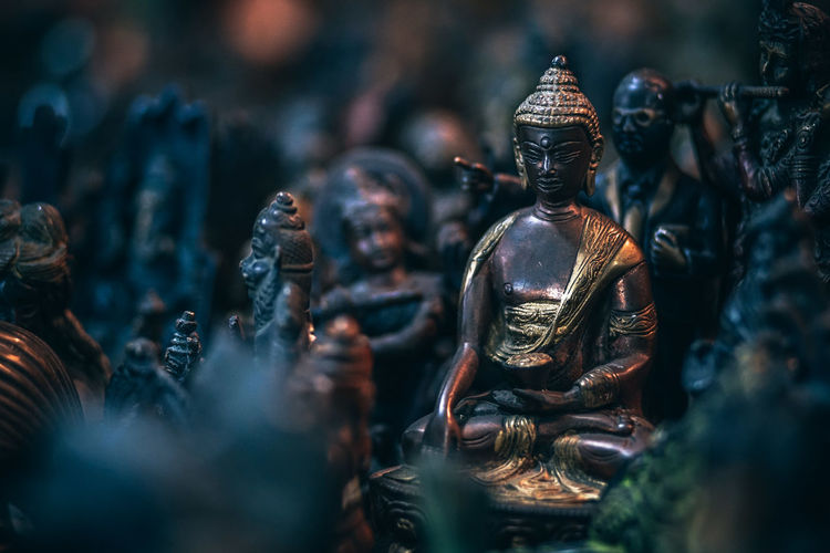 Close-up of buddha statue at market stall