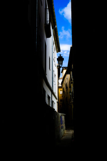 Granada Granada, Spain Minimalist Minimalist Architecture Alley Architecture Building Building Exterior Built Structure City Cloud - Sky Copy Space Dark House Minimalism Narrow Nature No People Outdoors Residential District Silhouette Sky Street Transportation Window