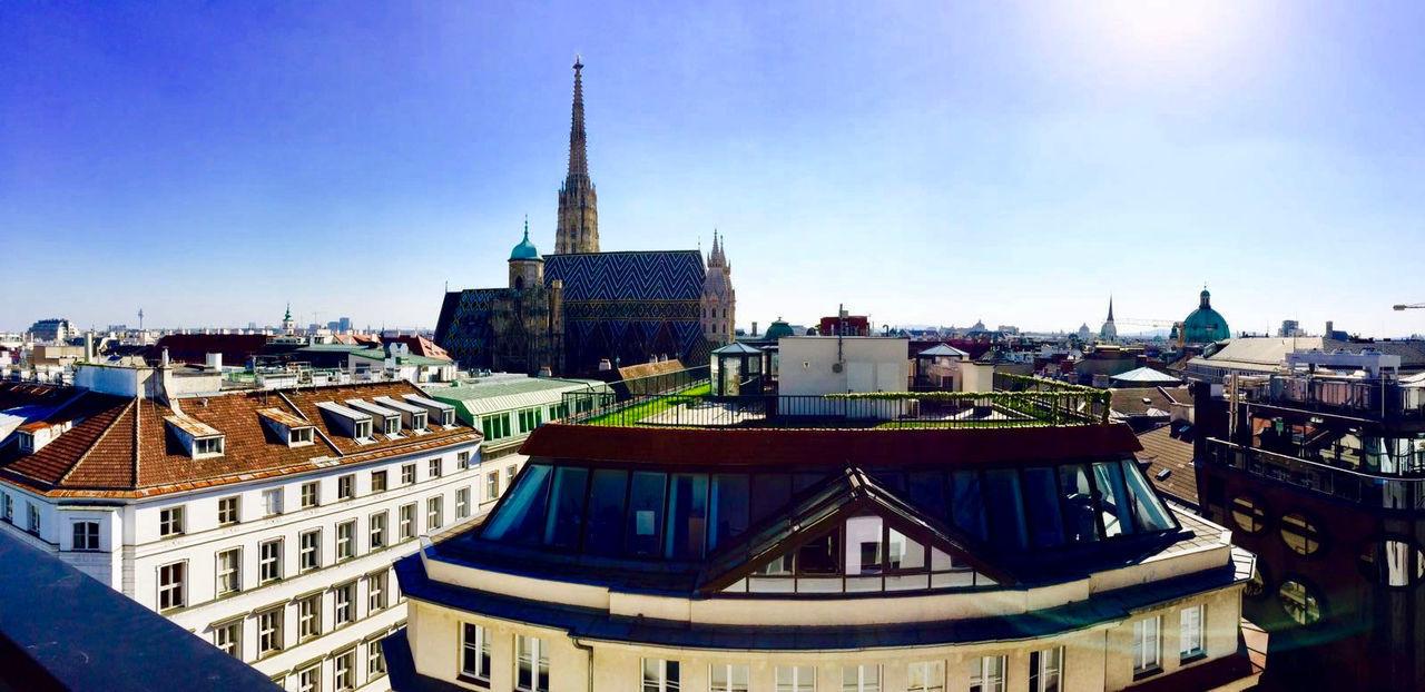 Cityscape Against Blue Sky