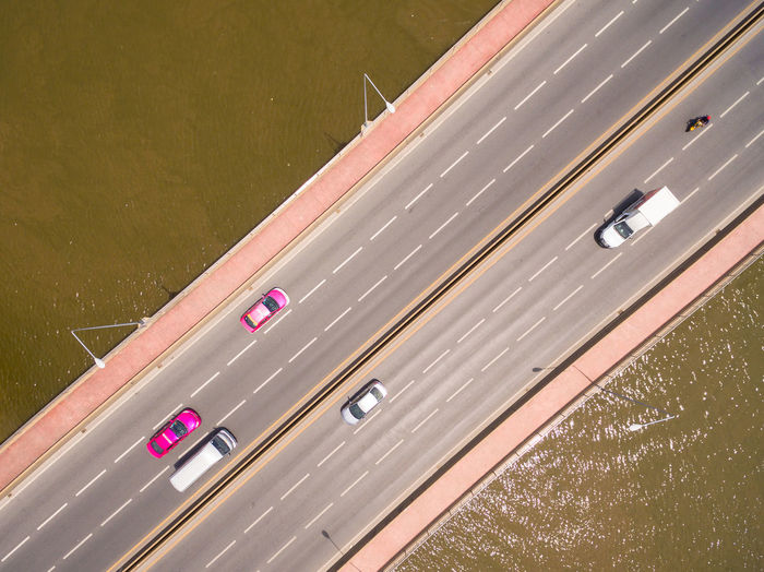 Aerial View Of Vehicles Moving On Bridge Over Sea