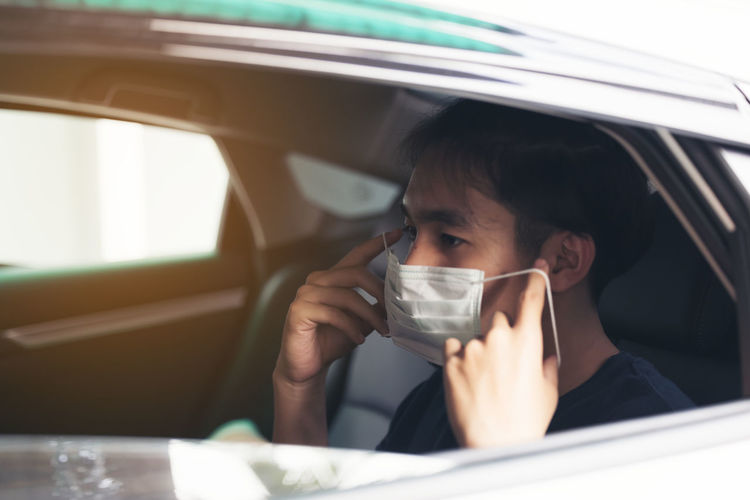 Young man wearing sterile medical mask coronavirus pandemic. social distance concept.