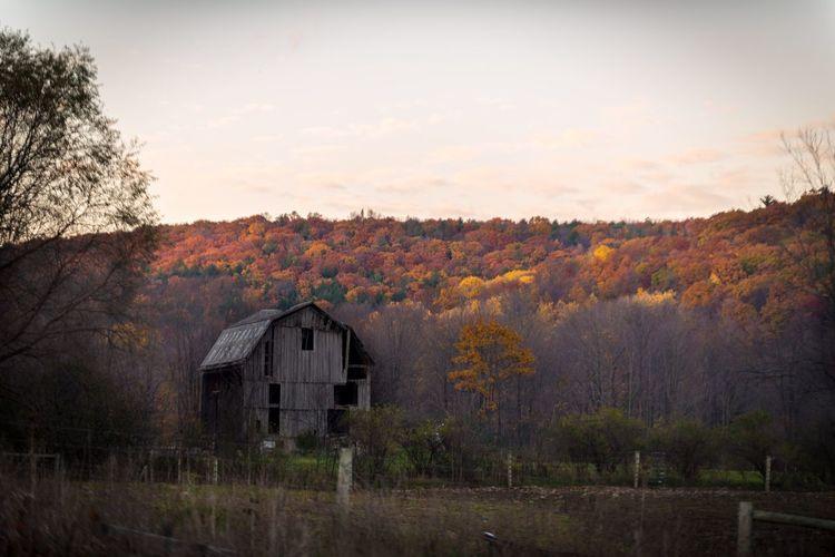 Built structure on landscape against sky during autumn