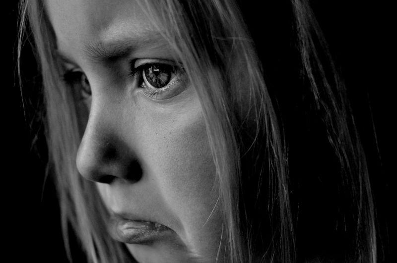 Close-Up Of Sad Girl Looking Away