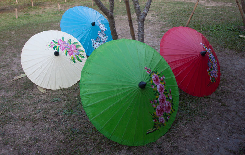 High angle view of multi colored umbrella on land