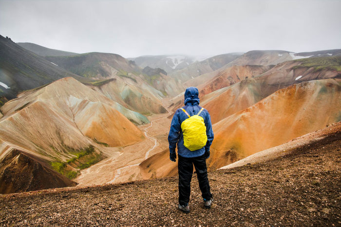 Iceland Travel Activity Adventure Backpack Beauty In Nature Environment Full Length Hiking Landmanalaugar Landscape Leisure Activity Lifestyles Mountain Mountain Range Nature One Person Outdoors Real People Rear View Scenics - Nature Sky Travel Travel Destinations