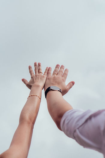 Human Hand Human Body Part Hand Body Part Lifestyles People Real People Togetherness Women Leisure Activity Human Finger Day Sky Finger Bonding Adult Nature Men Human Arm Arms Raised Human Limb Love New Couple