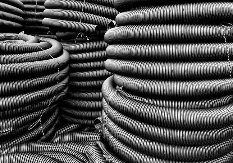 Stack Of Plastic Pipes In Store