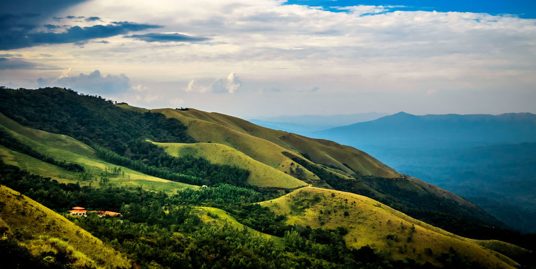 Panoramic views of the beautiful mountain slopes in Kudremukh, Chikmagalur Beautiful Chikmagalur Exploring Mountain View Travel Travel Photography Beauty In Nature Cloud - Sky Day Karnataka Kudremukh Landscape Mountain Mountain Range Mountains Nature No People Outdoors Scenics Sky Tourism Tranquil Scene Tranquility Travel Destinations Tree