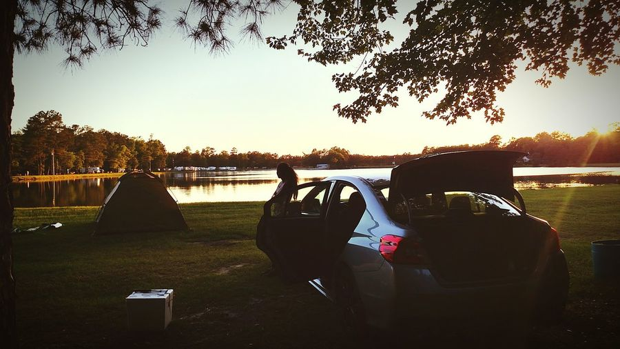 Camping with my beautiful woman. The Subaru Wrx had no problem digging through the mud and dirt to get there.