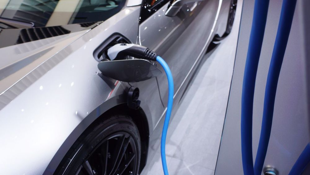 Fast Charge Lithium Hybrid Electric EyeEm Selects Car Transportation Land Vehicle Mode Of Transport Driving Side-view Mirror Gasoline Day Motion Outdoors Refueling No People