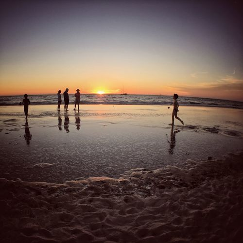 Silhouette of people on beach