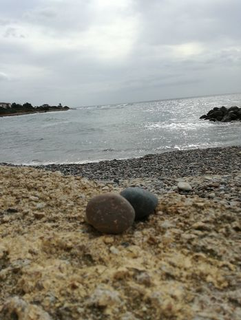 Beach Sea Nature Tranquil Scene Water Tranquility Pebble Stone - Object Sky No People Sand Beauty In Nature Outdoors Day Scenics Horizon Over Water Pebble Beach Reflection Landscape Large Group Of Objects Palm Tree First Eyeem Photo Cloud - Sky