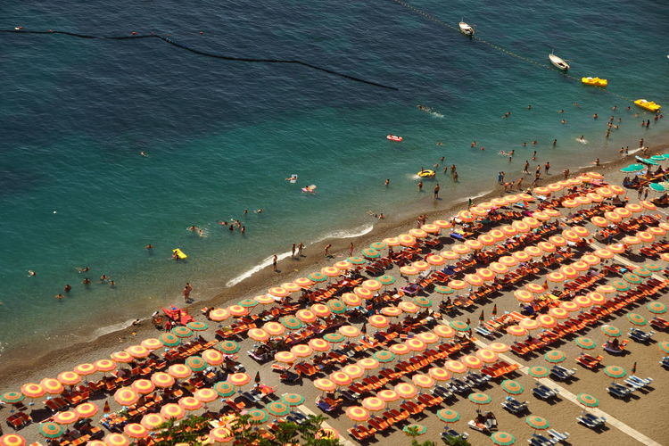 High Angle View Of People And Parasols At Beach