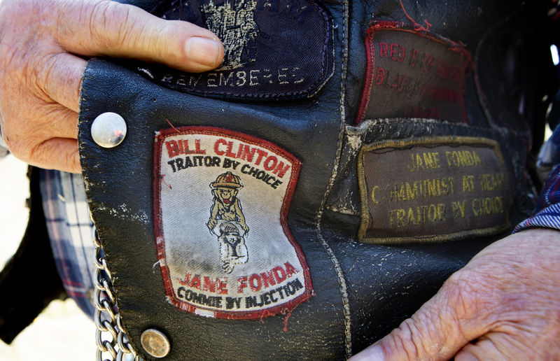 A Vietnam Veteran shows his patch on a motorcycle vest deriding former President Bill Clinton and actor Jane Fonda. Jane Fonda was criticized during the Vietnam War as being a traitor by many soldiers and Americans because of actor's visit to North Vietnam in July of 1972. She earned the nickname Hanoi Jane. Human Hand Human Body Part Hand Real People Body Part People Text Western Script Close-up Holding Finger Human Finger Lifestyles Men Communication Unrecognizable Person Day Detail Indoors  Government Human Limb Bill Clinton Jane Fonda Vietnam Veteran War War Veteran Photojournalism