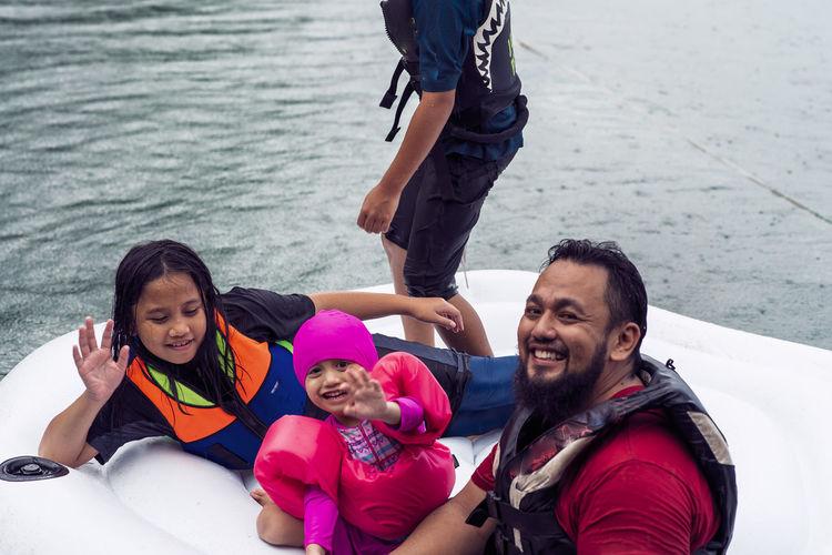 Portrait of happy family enjoying in water