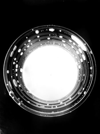 Milk in a glass, held in a plastic glass. Black Background Concentric Illuminated Studio Shot Circle Close-up Abstract Backgrounds Gramophone Color Gradient Abstract Entertainment Amusement Park Ride Geometric Shape Textured Effect Wave Pattern Audio Equipment Record Player Needle Spiral Staircase Marbled Effect Turntable Brushed Metal Semi-circle Record Light Painting Quartz Ice Crystal