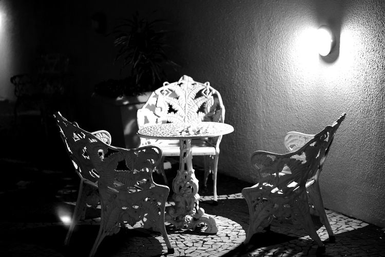 50mm 50mm F1.8 Black & White Chair Home Home Exterior Home Sweet Home Nikon Black And White Blackandwhite Photography Chair Close-up Furniture Illuminated Iron Chair Living Room Night Nikonphotography Table Tablecloth Black And White Friday Black And White Friday