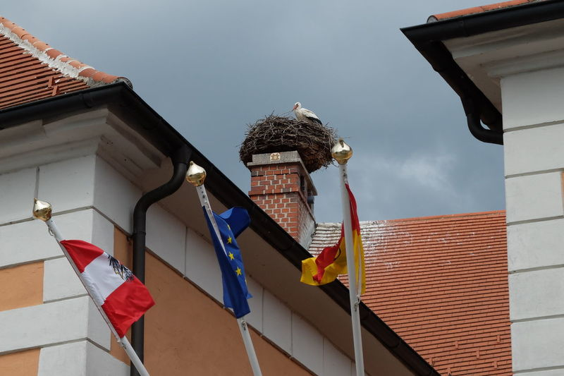 flags Architecture Building Exterior Built Structure Day Flag House International Stork Low Angle View No People Outdoors Sky Sorkun Stork And Flad Stork´s Nest