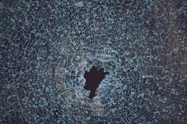 Close-up of broken glass pane