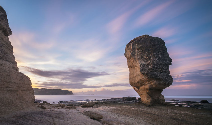 Batu Payung in twilight at Kuta, Lombok, Indonesia. Used a 10-stop ND to catch the dramatic movement of the clouds. Beach Beauty In Nature Dramatic Sky EyeEm Best Shots EyeEm Nature Lover EyeEmNewHere Face Horizon Over Water INDONESIA Landscape Landscape_photography Lombok Long Exposure Nature No People Outdoors Rock Rock - Object Rock Formation Sea Shore Sky Sunrise Sunrise_sunsets_aroundworld Twilight